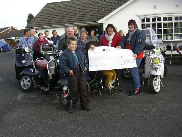 Lad's & Lasses make a donation